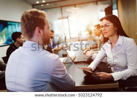 Picture of attractive businesspeople in conference room #1023124792