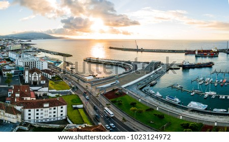 City view on the old town with harbor at Ponta Delgada, capital city of the Azores at Sao Miguel Island. Beautiful aerial old town by the ocean. #1023124972