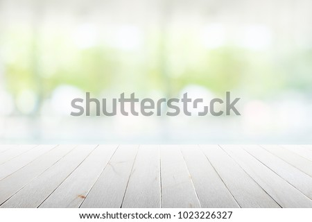 Wood flooring with glass office. atmosphere around office  blur background with bokeh. Royalty-Free Stock Photo #1023226327