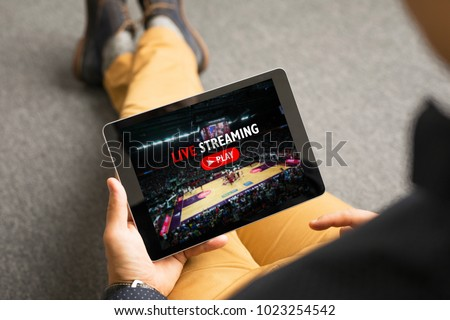 Man watching sports on live streaming online service