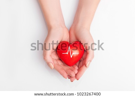 People health concept - close up of woman's cupped hands showing red heart with heart beat. #1023267400