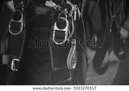 Sport parachutes, packed before jumping, are stored in a parachute packing room, close-up. Parachute equipment.Black and white. Stylization under the photo made on black-and-white film. #1023270157