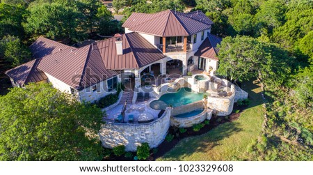 Rich Luxury mansion on large lot of land with Texas hill country landscape and surrounding green surroundings of the ranch country home with infinity pool and wealthy real estate living #1023329608