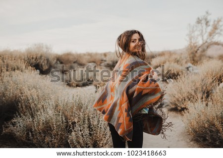 Boho woman with windy hair. Hipster girl in gypsy look, young traveler in the desert nature. #1023418663
