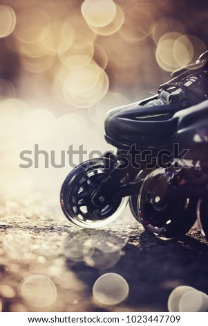 Wheels of roller skates closeup in the rays of the sun. #1023447709