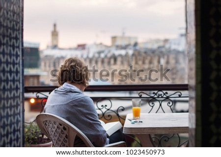Woman enjoying view of Fez town from above. Morocco #1023450973