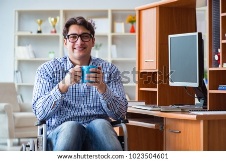 Disabled student studying at home on wheelchair #1023504601
