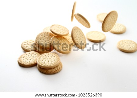 Marie biscuit in white background / A Marie biscuit is a type of biscuit similar to a rich tea biscuit. #1023526390