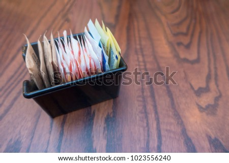 white, pink, blue, brown, sugar bags for coffee,tea and drinks Royalty-Free Stock Photo #1023556240