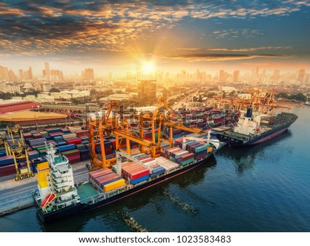 Logistics and transportation of Container Cargo ship and Cargo plane with working crane bridge in shipyard at sunrise, logistic import export and transport industry background #1023583483