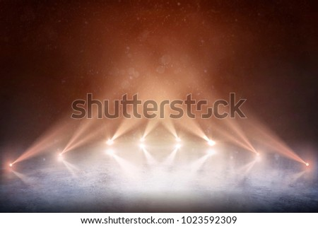 Background. Professional hockey stadium and an empty ice rink with lights.