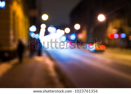 Blurred Photo, cityscape at twilight time, Traffic lights of the night city road. #1023761356