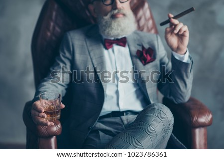 Cropped close up photo of serious confident stylish trendy classy chic elegant professional groomed man having freetime, focus on glasses with beverage blurred background isolated on grey background #1023786361