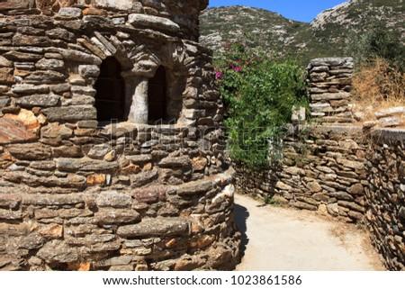 Moni, Naxos / Greece - August 25, 2014: The church of Panagia Drossiani nea Moni village, Naxos, Cyclades Islands, Greece #1023861586
