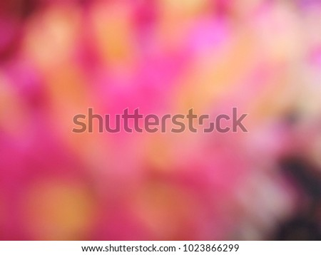 Abstract out of focus lights coming from the mother nature with abstract background of Red flower. Abstract background of Red, Yellow and white color. Good for Valentines Day celebrations.  #1023866299