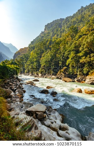 Beautiful mountain landscape in Himalayas, Manaslu region, Nepal. Sunny day of Nepal Winter, december 2017. Big mountains, blue river and fresh air. #1023870115