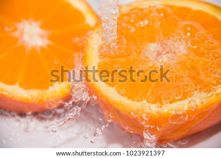 Fruit. Pure water. Drops of water on the fruit. Orange, Mandarin. #1023921397
