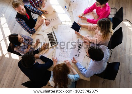 Picture of young architects discussing in office #1023942379