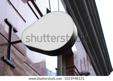 Blank advertising board on city building outdoors #1023948121