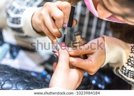 woman paints nails #1023984184