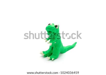 Colorful Play dough T- rex or Tyrannosaurus Rex or dinosaur create mold by boy hands isolated on white background with copy space for text. Kids toys children's development concept.( Selective focus )