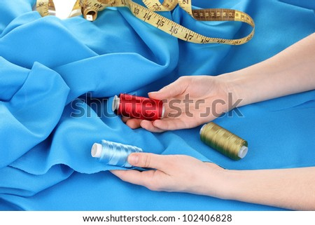 Woman choosing color of threads #102406828