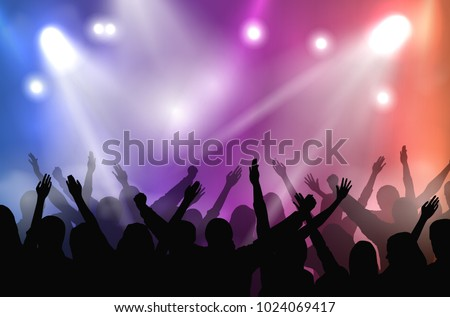 Vector concert stage illuminated with colorful lights and silhouettes of cheering crowd #1024069417