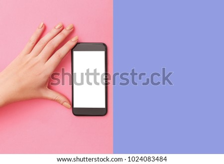hand holding phone on pink background clipping path inside