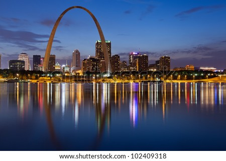 City of St. Louis skyline. Image of St. Louis downtown with Gateway Arch at twilight.