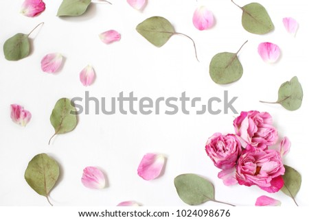 Styled stock photo. Feminine wedding desktop composition with pink roses petals and flowers, dry green eucalyptus leaves and white background. Floral pattern. Empty space. Top view. Picture for blog. #1024098676