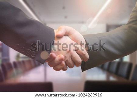 Business people shaking hands in the meeting room after successful meeting #1024269916