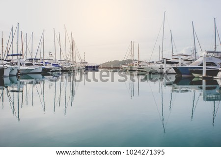 Yachts parking in harbor at sunset, Harbor yacht club in Thailand Royalty-Free Stock Photo #1024271395