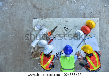 Engineers and foremen are meeting to plan for new project for construction. #1024385692