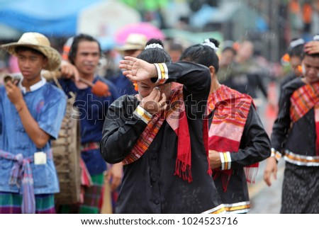 people at the rocket festival or Bun Bang Fai in Yasothon in Isan in north east Thailand.    Thailand, Yasothon, May, 2012 #1024523716