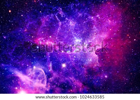 Bursting Galaxy - Elements of This Image Furnished by NASA Royalty-Free Stock Photo #1024633585