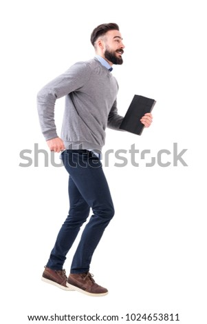 Funny excited young smart casual business man running with notebook in hands. Full body length portrait isolated on white studio background. #1024653811