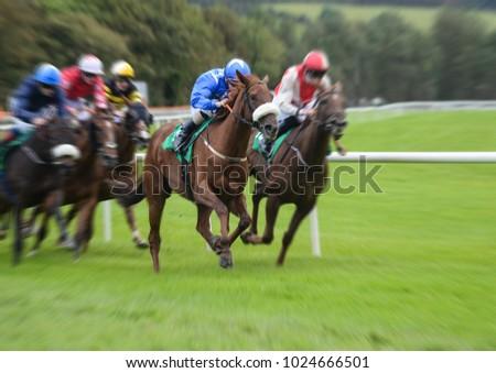 Galloping motion blur horserace #1024666501