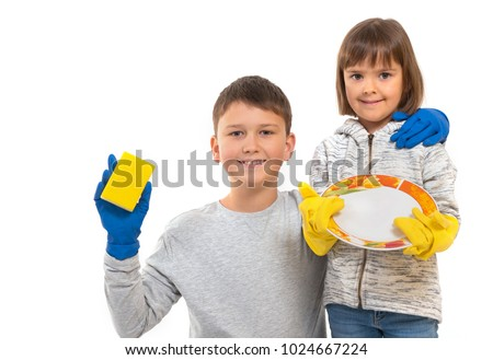 A smiling boy and girl in rubber gloves holding dishes in their hands at the white isolated background. #1024667224