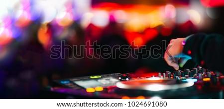 Music Background DJ Night Club Deejay Record Player Retro Blurred Crowd Dancing Royalty-Free Stock Photo #1024691080