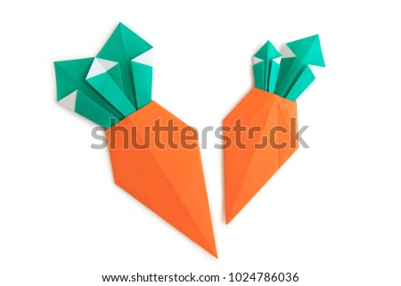 Origami for kids :Big carrot made from folded paper on white background isolated.Natural light, copy space for text.Top view, flat lay.Easy to use for card. #1024786036