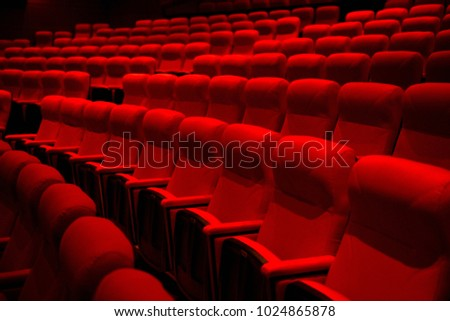 Empty theater seats , Rows of theater red seats , Red chairs in empty cinema theater with empty stage. #1024865878