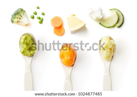 Green, yellow and orange baby puree in baby spoon isolated on white background, top view Royalty-Free Stock Photo #1024877485