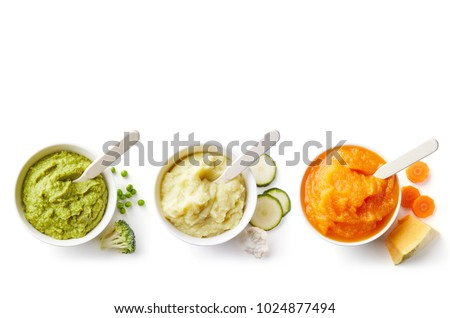 Green, yellow and orange baby puree in bowl isolated on white background, top view Royalty-Free Stock Photo #1024877494