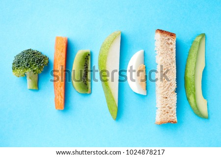 Baby finger food on blue background, top view #1024878217