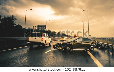 road accident in rainy highway Royalty-Free Stock Photo #1024887811