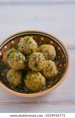 Beef meatballs with rice, onion and carrot in broth. vertical #1024936771