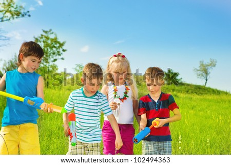 Kids group with water pumpers #102494363