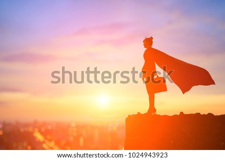 silhouette of super business woman look somewhere on the mountain Royalty-Free Stock Photo #1024943923