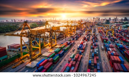 Logistics and transportation of Container Cargo ship and Cargo plane with working crane bridge in shipyard at sunrise, logistic import export and transport industry background #1024967245