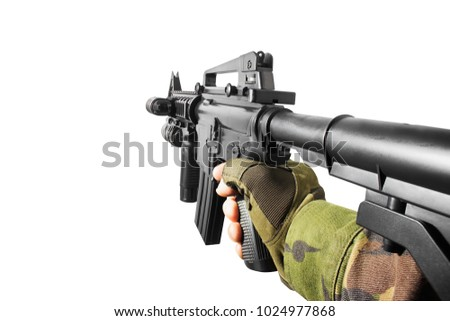VR view hand holding a rifle. Vr first person view of a soldier hand holding automatic rifle side view. #1024977868